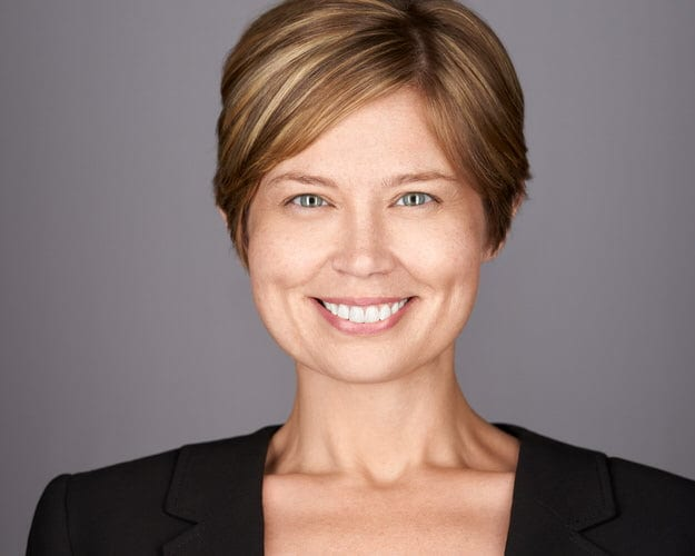 Business woman gets new business headshot for Linkedin.